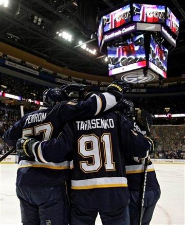 St. Louis Blues' Vladimir Tarasenko (91) is congratulated by teammates after scoring a goal in the second period of an NHL hockey game against the Los Angeles Kings, Thursday, March 28, 2013, in St. Louis. (AP Photo/Tom Gannam) By Tom Gannam
