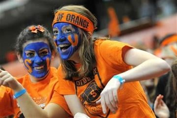 Syracuse University fans cheer their team against the USF defense during an NCAA college football game, Friday, Nov. 11, 2011, in Syracuse, N.Y (AP Photo/Steve Jacobs) By Steve Jacobs
