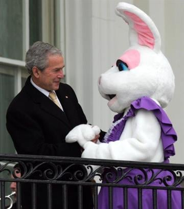 US President George W. Bush greets the Easter Bunny during the annual Easter Egg Roll on the South Lawn of the White House in Washington, DC, on March 24, 2008.  AFP PHOTO/SAUL LOEB (Photo credit should read SAUL LOEB/AFP/Getty Images) By SAUL LOEB