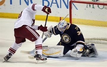 St. Louis Blues goaltender Jake Allen catches a puck in his pad shot by Phoenix Coyotes Antoine Vermette in the first period at the Scottrade Center in St. Louis on March 14, 2013.    UPI/Bill Greenblatt By BILL GREENBLATT