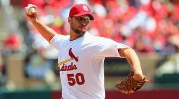 ST. LOUIS, MO - APRIL 19: Starter Adam Wainwright #50 of the St. Louis Cardinals pitches against the Cincinnati Reds at Busch Stadium on April 19, 2012 in St. Louis, Missouri.  (Photo by Dilip Vishwanat/Getty Images) By Dilip Vishwanat
