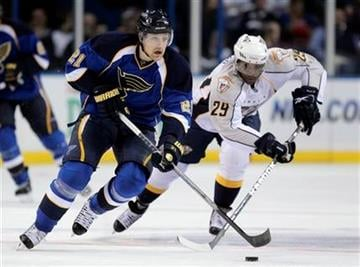 St. Louis Blues' Patrik Berglund, left, of Sweden, brings the puck up the ice as Nashville Predators' Joel Ward gives chase during the first period of an NHL hockey game Thursday, Nov. 11, 2010, in St. Louis. (AP Photo/Jeff Roberson) By Jeff Roberson