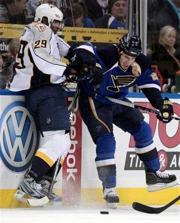 Nashville Predators' Joel Ward, left, and St. Louis Blues' Alexander Steen get tied up along the boards during the first period of an NHL hockey game Thursday, Nov. 11, 2010, in St. Louis. (AP Photo/Jeff Roberson) By Jeff Roberson