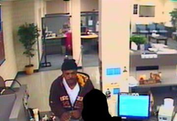 The man seen in this surveillance photo is wanted in connection to a robbery at the American Eagle Credit Union in south St. Louis. The robbery happened on Friday, November 12, 2010.