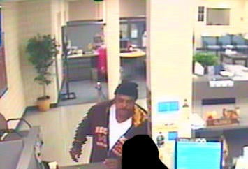 The man seen in this surveillance photo is wanted in connection to a robbery at the American Eagle Credit Union in south St. Louis. The robbery happened on Friday, November 12, 2010. By KMOV Web Producer