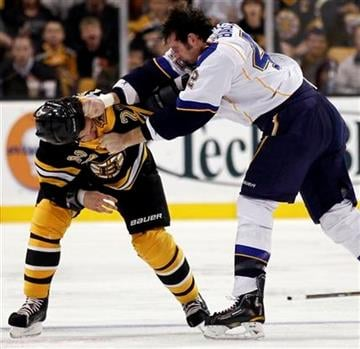 St. Louis Blues center David Backes, right, fights with Boston Bruins defenseman Andrew Ference during the second period of a NHL hockey game in Boston Saturday, Nov. 6, 2010. (AP Photo/Winslow Townson) By Winslow Townson