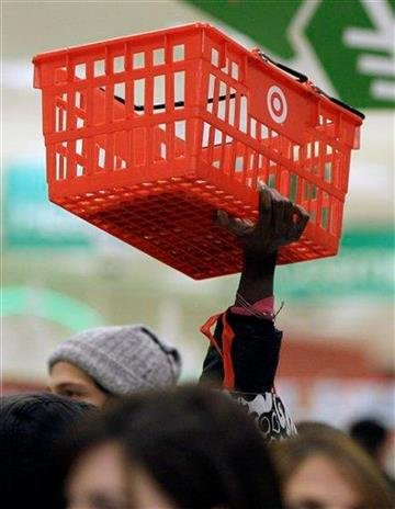 A customer tries to make her way through the crowds looking for bargains during the traditional Black Friday shopping day at the Target store in Mayfield Hts., Ohio early on Friday morning Nov. 27, 2009.   (AP Photo/Amy Sancetta) By Amy Sancetta