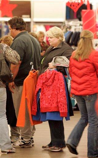 Shoppers puckup Black Friday bargains at a Little Rock, Ark., Old Navy store shortly after 3:00am Friday, Nov. 27, 2009. (AP Photo/Danny Johnston) By Danny Johnston