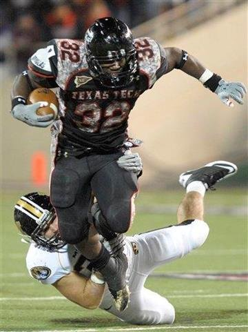 Texas Tech's Aaron Crawford is tackled by Missouri's Will Ebner during the second half of an NCAA college football game Saturday, Nov. 6, 2010, in Lubbock, Texas.Texas Tech beat Missouri 24-17.(AP Photo John A. Bowersmith) By John A. Bowersmith