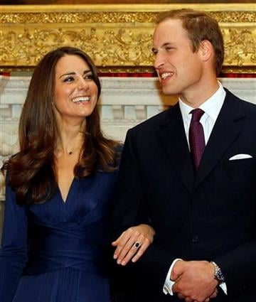 Britain's Prince William and his fiancee Kate Middleton pose for the media at St. James's Palace in London, Tuesday Nov. 16, 2010, after they announced their engagement. The couple are to wed in 2011. (AP Photo/Kirsty Wigglesworth) By Kirsty Wigglesworth