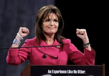 Former Republican vice presidential candidate Sarah Palin gestures as she addresses the National Quartet Convention in Louisville, Ky., Thursday, Sept. 16, 2010.  (AP Photo/Ed Reinke) By Ed Reinke