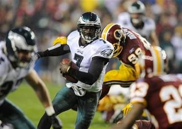 Philadelphia Eagles quarterback Michael Vick (7) rushes during the first half of an NFL football game against the Washington Redskins, Monday, Nov. 15, 2010, in Landover, Md. The Eagles won 59-28. (AP Photo/Nick Wass) By Nick Wass