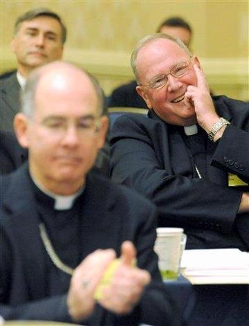 Archbishop Timothy Dolan, right, of New York reacts after being elected president of the U.S. Conference of Catholic Bishops during the conference's annual fall meeting Tuesday, Nov. 16, 2010 in Baltimore. (AP Photo/Steve Ruark) By Steve Ruark