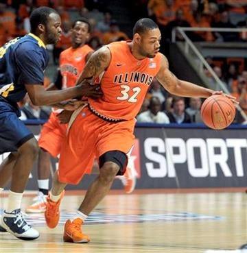 Illinois' Demetri McCamey (32) keeps the ball away from Toledo's Malcolm Griffin (23) in the first half of an NCAA college basketball game at Assembly Hall in Champaign, Ill., on Wednesday, Nov. 10, 2010. (AP Photo/John Dixon) By John Dixon