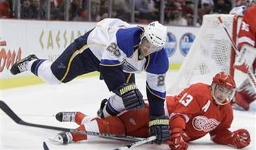 St. Louis Blues winger Brad Boyes (22) trips over Detroit Red Wings center Pavel Datsyuk (13), of Russia, during the first period of an NHL hockey game in Detroit, Wednesday, Nov. 17, 2010. (AP Photo/Carlos Osorio) By Carlos Osorio