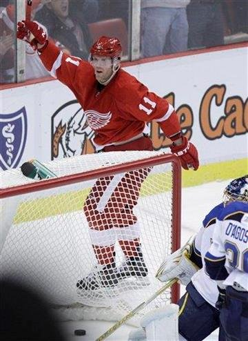 Detroit Red Wings winger Dan Cleary (11) celebrates his goal during the third period of an NHL hockey game against the St. Louis Blues in Detroit, Wednesday, Nov. 17, 2010. Detroit won 7-3. (AP Photo/Carlos Osorio) By Carlos Osorio