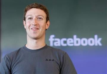Facebook CEO Mark Zuckerberg smiles during an announcement in San Francisco, Monday, Nov. 15, 2010. AP Photo/Paul Sakuma) By Paul Sakuma