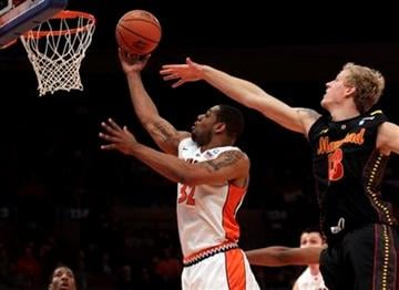 Illinois' Demetri McCamey (32) drives past Maryland's Haukur Palsson (13) in the first half of an NCAA college basketball game at the 2K Sports Classic tournament Friday, Nov. 19, 2010  in New York.  (AP Photo/Frank Franklin II) By Frank Franklin II