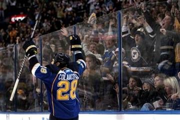 St. Louis Blues' Carlo Colaiacovo celebrates after scoring as fans cheer during the second period of an NHL hockey game against the Ottawa Senators, Friday, Nov. 19, 2010, in St. Louis. (AP Photo/Jeff Roberson) By Jeff Roberson