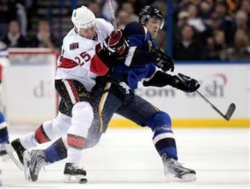 Ottawa Senators' Chris Neil, left, and St. Louis Blues' Patrik Berglund, of Sweden, chase after a loose puck during the second period of an NHL hockey game Friday, Nov. 19, 2010, in St. Louis. (AP Photo/Jeff Roberson) By Jeff Roberson