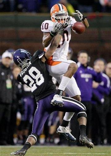 Illinois wide receiver Eddie McGee(10) can't make the catch against Northwestern's Justan Vaughn during second the quarter of an NCAA college football game at Wrigley Field in Chicago on Saturday, Nov. 20, 2010. (AP Photo/Nam Y. Huh) By Nam Y. Huh