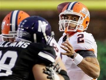 Illinois quarterback Nathan Scheelhaase looks to a pass during the quarter of an NCAA college football game against Northwestern at Wrigley Field in Chicago on Saturday, Nov. 20, 2010. (AP Photo/Nam Y. Huh) By Nam Y. Huh