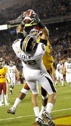 Missouri's Michael Egnew, foreground, catches a touchdown pass as Iowa State's Ter'Ran Benton defends during first half of an NCAA college football game in Ames, Iowa., Saturday, Nov. 20, 2010. (AP Photo/Steve Pope) By Steve Pope