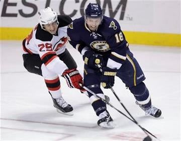 St. Louis Blues' Jay McClement (18) keeps the puck away from New Jersey Devils' Olivier Magnan (29) in the third period of a NHL hockey game, Saturday, Nov. 20, 2010 in St. Louis. The Blues beat the Devils 3-2.(AP Photo/Tom Gannam) By Tom Gannam