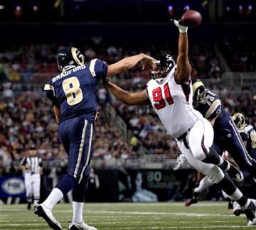 Atlanta Falcons defensive tackle Corey Peters (91) pressures St. Louis Rams quarterback Sam Bradford (8) during the first quarter of an NFL football game Sunday, Nov. 21, 2010, in St. Louis. (AP Photo/Tom Gannam) By Tom Gannam