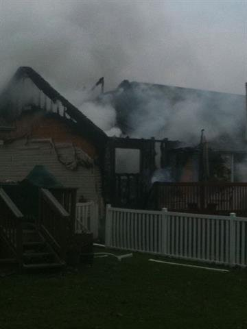 This November 21, 2010 photo shows smoke from a fire billowing from a home in Imperial, Missouri.