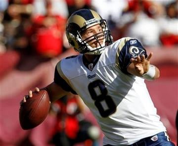 St. Louis Rams quarterback Sam Bradford  looks to  throw against the San Francisco 49ers during the first quarter of an NFL football game in San Francisco, Sunday, Nov. 14, 2010. (AP Photo/Paul Sakuma) By Paul Sakuma