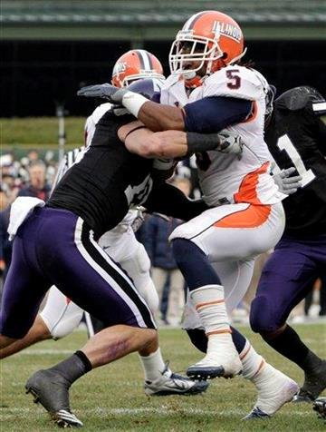 Illinois running back Mikel Leshoure (5) is tackled by Northwestern's Brian Peters during the first quarter of an NCAA college football game at Wrigley Field in Chicago on Saturday, Nov. 20, 2010. (AP Photo/Nam Y. Huh) By Nam Y. Huh