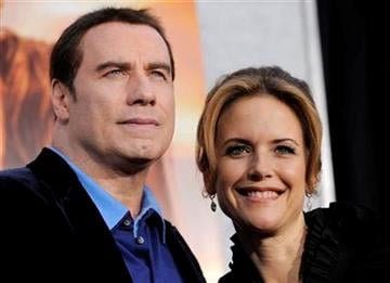 """FILE - In this March 25, 2010 file photo, Kelly Preston, right, a cast member in """"The Last Song,"""" arrives with her husband John Travolta at the premiere of the film in Los Angeles. (AP Photo/Chris Pizzello, file) By Chris Pizzello"""