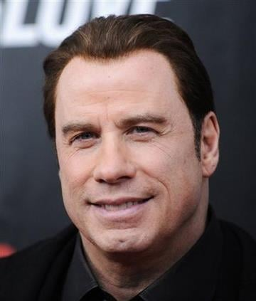 """Actor John Travolta attends the premiere of """"From Paris With Love"""" at the Ziegfeld Theatre on Thursday, Jan. 28, 2010 in New York. (AP Photo/Evan Agostini) By Evan Agostini"""