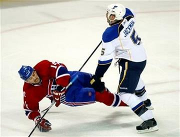 Montreal Canadiens' Tomas Plekanec, of Czech Republic, is checked by St. Louis Blues' Barret Jackman during the second period of an  NHL hockey game on Wednesday, Jan.  20, 2010 in Montreal.  (AP Photo/The Canadian Press,Paul Chiasson) By Paul Chiasson