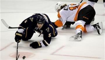St. Louis Blues' Barret Jackman, left, reaches for a loose puck along side Philadelphia Flyers' Scott Hartnell during the first period of an NHL hockey game Saturday, Oct. 9, 2010, in St. Louis. (AP Photo/Jeff Roberson) By Jeff Roberson