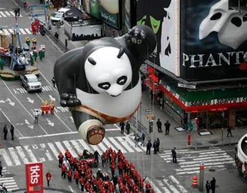 The Kung Fu Panda Balloon floats through Times Square during the Macy's Thanksgiving Day parade in New York, Thursday, Nov. 25, 2010.  (AP Photo/Jeff Christensen) By Jeff Christensen