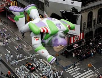 The Buzz Lightyear balloon floats through Times Square during the Macy's Thanksgiving Day parade in New York, Thursday, Nov. 25, 2010.  (AP Photo/Jeff Christensen) By Jeff Christensen