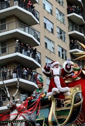 Santa Claus waves at the crowd during the Macy's Thanksgiving Day Parade in New York Thursday, Nov. 25, 2010.  (AP Photo/Craig Ruttle) By Craig Ruttle