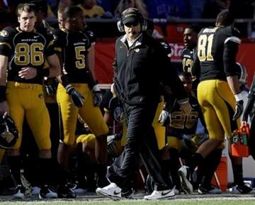 Missouri coach Gary Pinkel walks the side line during the first half of an NCAA college football game against Kansas at Arrowhead Stadium in Kansas City, Mo., Saturday, Nov. 27, 2010. (AP Photo/Orlin Wagner) By Orlin Wagner