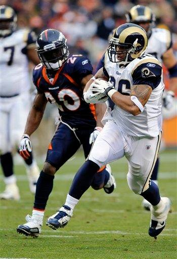 St. Louis Rams tight end Michael Hoomanawanui (86) runs for a touchdown against Denver Broncos safety Brian Dawkins (20) during the first half of an NFL football game Sunday, Nov. 28, 2010, in Denver. (AP Photo/Chris Schneider) By Chris Schneider