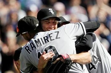 Chicago White Sox starting pitcher Phil Humber, center, is mobbed by teammates after pitching a perfect baseball game against the Seattle Mariners, Saturday, April 21, 2012, in Seattle. The White Sox won 4-0. (AP Photo/Elaine Thompson) By Elaine Thompson