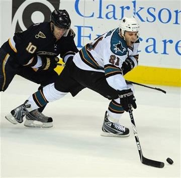 San Jose Sharks' Scott Nichol (21) skates around St. Louis Blues' Andy McDonald (10) in the third period of an NHL hockey game Saturday, Nov. 14, 2009 in St. Louis. (AP Photo/Bill Boyce) By Bill Boyce