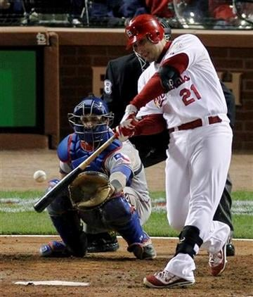 St. Louis Cardinals' Allen Craig hits a solo home run off a pitch by Texas Rangers' Derek Holland during the eighth inning of Game 6 of baseball's World Series Thursday, Oct. 27, 2011, in St. Louis. (AP Photo/Jeff Roberson) By Jeff Roberson