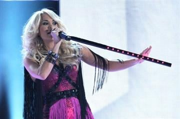 LAS VEGAS, NV - APRIL 01:  Singer Carrie Underwood performs onstage at the 47th Annual Academy Of Country Music Awards held at the MGM Grand Garden Arena on April 1, 2012 in Las Vegas, Nevada.  (Photo by Ethan Miller/Getty Images) By Ethan Miller