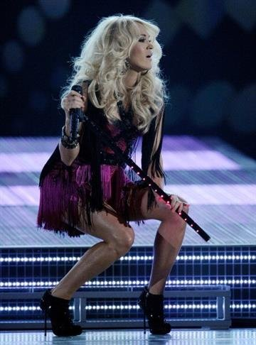 LAS VEGAS, NV - APRIL 01:  Singer Carrie Underwood performs during the 47th Annual Academy of Country Music Awards at the MGM Grand Garden Arena April 1, 2012 in Las Vegas, Nevada.  (Photo by Ethan Miller/Getty Images) By Ethan Miller