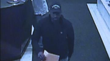 Surveillance image allegedly showing the man who Combs said used a bad check to buy his Mercedes-Benz. By Dan Mueller