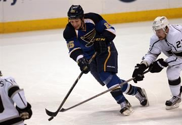 St. Louis Blues Chris Stewart bats down the puck in front of Los Angeles Kings Trevor Lewis in the first period at the Scottrade Center in St. Louis on May 8, 2013.   UPI/Bill Greenblatt By BILL GREENBLATT
