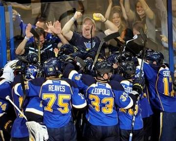 St. Louis Blues players celebrate their 2-1 overtime win over the Los Angeles Kings in Game 1 of their first-round NHL hockey Stanley Cup playoff series, Tuesday, April 30, 2013, in St. Louis. (AP Photo/Bill Boyce) By Bill Boyce