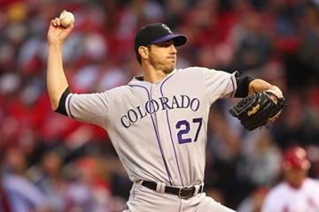 ST. LOUIS, MO - MAY 10: Starter Jon Garland #27 of the Colorado Rockies pitches against the St. Louis Cardinals at Busch Stadium on May 10, 2013 in St. Louis, Missouri.  (Photo by Dilip Vishwanat/Getty Images) By Dilip Vishwanat